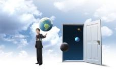 打开的房门和商务男士地球
