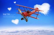 心形白云和红色滑翔机