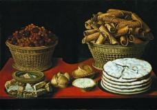 Hiepes Tomas  Dulces y frutos secos sobre una mesa First third of 17 Century静物植物动物食物家禽水果印象派写实主义油画